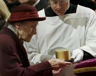 Franziska Jägerstätter, 94-year-old widow of Blessed Franz Jägerstätter, bearing a box with relics of his bod at his beatification in Linz, Austria